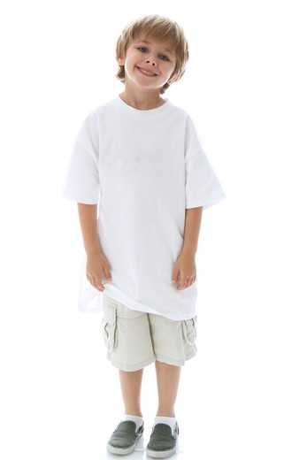 Stock Photo: 4113R-290 Studio shot portrait of boy standing and smiling