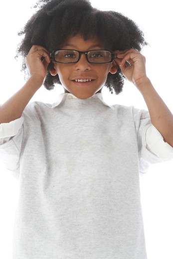 Studio shot portrait of boy with glasses smiling : Stock Photo