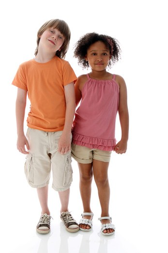 Stock Photo: 4113R-294 Studio shot of boy standing with girl