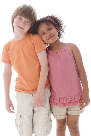 Stock Photo: 4113R-295 Studio shot of boy standing with girl
