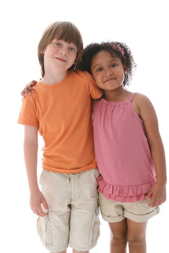 Studio shot of boy and girl standing and leaning on each other : Stock Photo