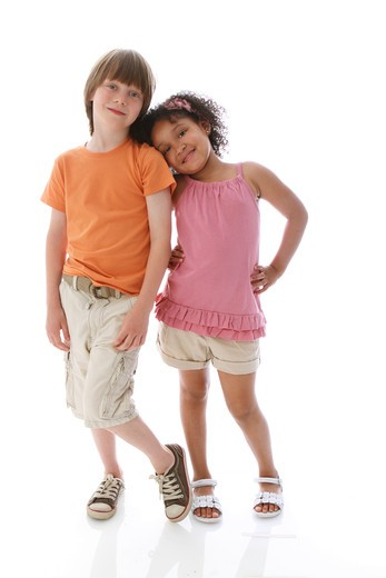 Stock Photo: 4113R-297 Studio shot of boy and girl standing and leaning on each other
