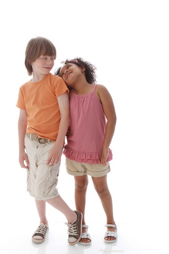 Stock Photo: 4113R-298 Studio shot of boy standing girl looking at each other