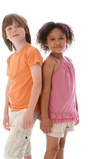 Stock Photo: 4113R-299 Studio shot of boy standing with girl looking at each other