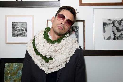 Stock Photo: 4114-112 Portrait of a man wearing sunglasses in a gallery