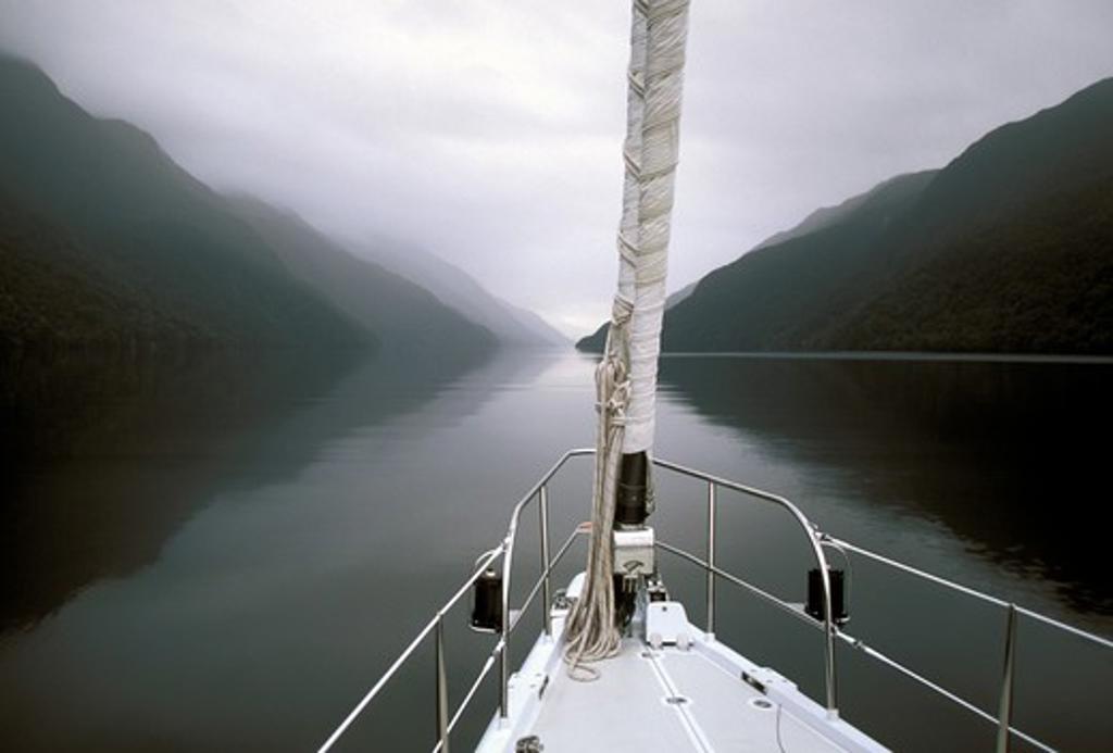Stock Photo: 4115-1081 The 88 foot sloop, 'Shaman', exploring Fiordland, South Island, New Zealand