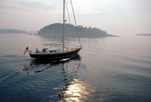 Stock Photo: 4115-1100 A Hinckley motoring on a calm morning in Maine, USA
