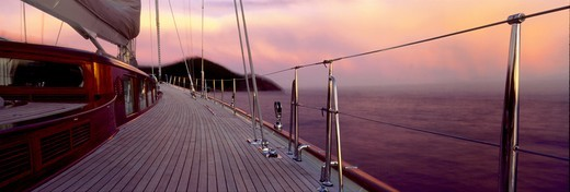 Stock Photo: 4115-1550 Ketch anchored in pink light off Antigua, Caribbean.