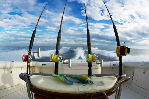 Heavy duty deep sea fishing reels lined up on the stern of a sport fishing boat, Guatemala. : Stock Photo