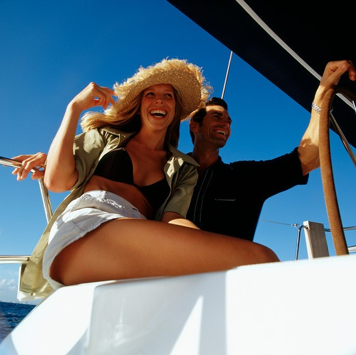 Stock Photo: 4115-1908 Happy couple cruising on a yacht 2002