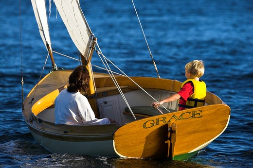 Stock Photo: 4115-1986 Cat rigged 12.5ft Herreshoff dinghy 'Grace', sailed by Adrian van der Wal, Newport, Rhode Island, USA.