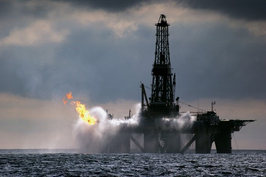 The oil rig J.W McLean flares off gas during drilling operations in the North Sea, September 2006 : Stock Photo