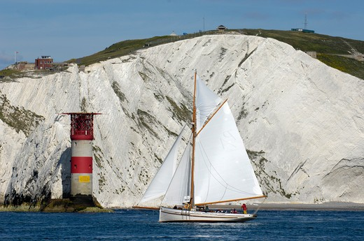 Stock Photo: 4115-2262 Pilot Cutter 'Polly Agatha' sailing past the Needles Lighthouse during Round the Island Race, The British Classic Yacht Club Regatta, Cowes Classic Week, July 2008