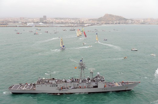 Stock Photo: 4115-2376 Navy ship and spectator boats gather for the start of leg one of the 10th Volvo Ocean Race in Alicante, Spain, October 2008.