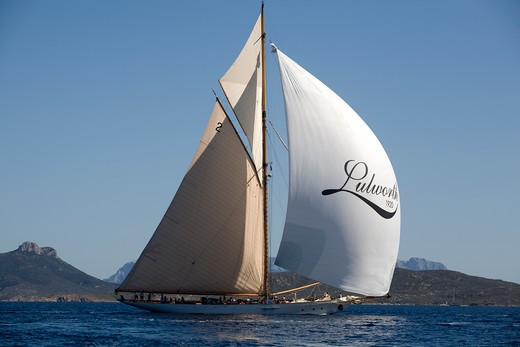 Stock Photo: 4115-2415 Lulworth' under full sails with spinnaker. 'Lulworth' is a big class Gaff Cutter built by the White Brothers in 1920, naval architect Herbert White, length 46.30m. Panerai Classics, Sardinia, September 2007.