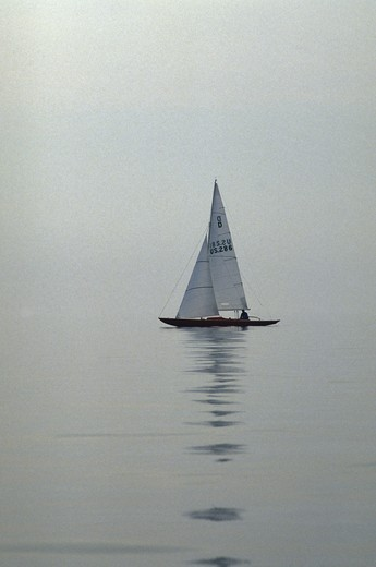 Stock Photo: 4115-277 Dragon yacht in the mist, Bay la Forest, 1990