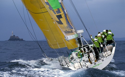 Stock Photo: 4115-2886 Volvo 60 'Illbruck' reaches the Fastnet Rock during the race, part of their training for the Volvo Ocean Race, 1999.