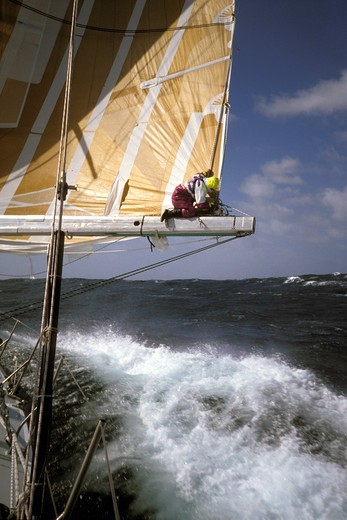 Stock Photo: 4115-2898 Crew on the boom aboard 'The Card' during the Whitbread Round the World Race, 1989-90.