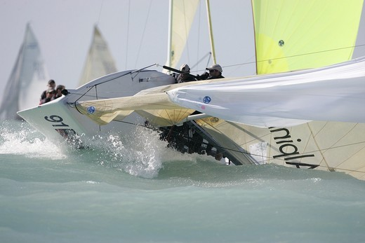 A sportboat takes the plunge in windy conditions during Key West Race Week 2006, Miami, Florida. : Stock Photo