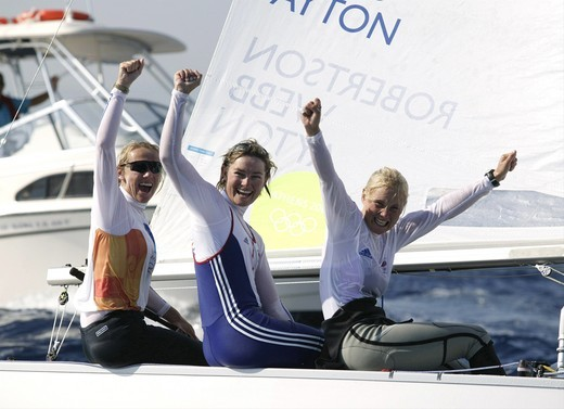 Women's Yngling crew Shirley Robertson, Sarah Webb and Sarah Ayton celebrate after winning Great Britain's first Gold Medal at the Olympic Games, Athens, 19 August 2004. : Stock Photo