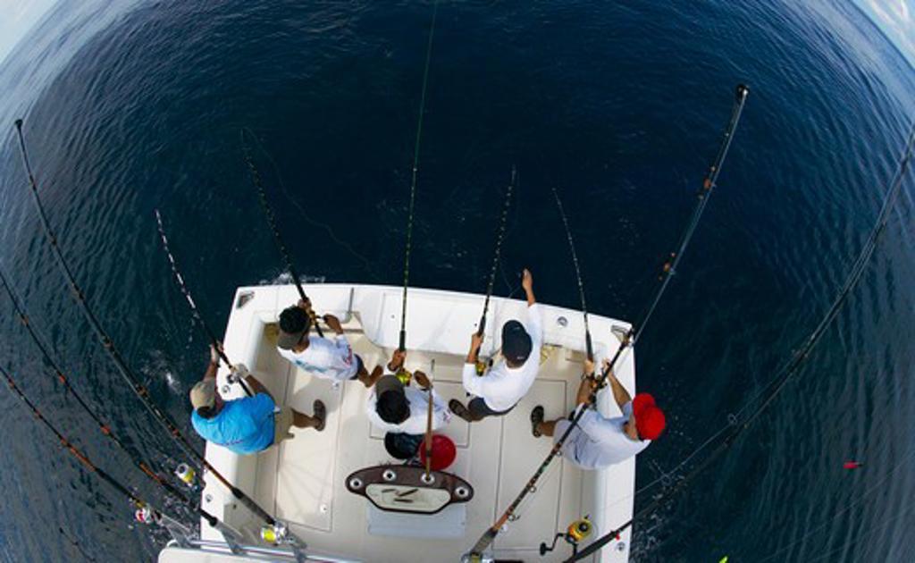 Deep sea fishing off the stern of a sport fishing boat, Guatemala. : Stock Photo
