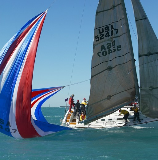 Spinnaker in the water tipping up the yacht during a spinnaker drop, Key West Race Week, Florida, 2005. : Stock Photo