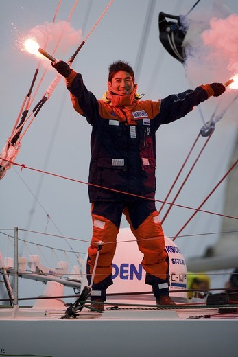 Kojiro Shiraishi onboard his Open 60 'Spirit of Yukoh', crossing the finish line of the final leg in the Velux 5 Oceans in second place at Gexto marina, Bilbao, Spain. 30th April 2007. Shiraishi came in less than an hour after the winner Bernard Stamm. : Stock Photo