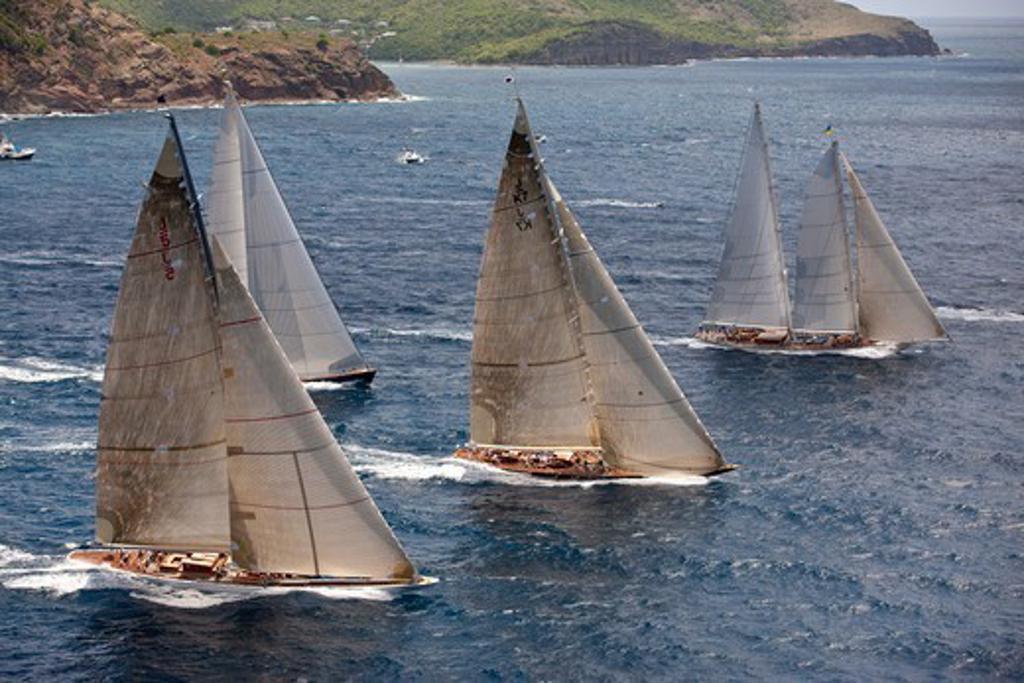 Stock Photo: 4115-3671 Fleet of yachts racing at the Panerai Antigua Classic Yacht Regatta, Caribbean, April 2010.