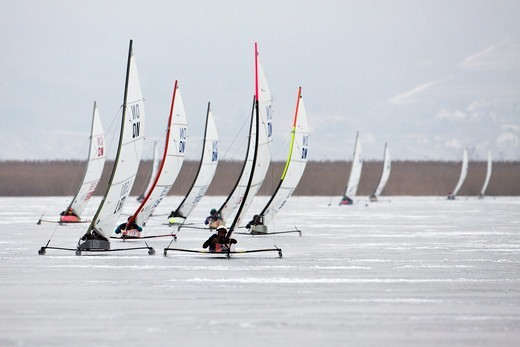 Stock Photo: 4115-3735 Fleet racing in the DN (Detroit News) Ice Sailing World Championship. Neusiedlersee, Austria, 2010.