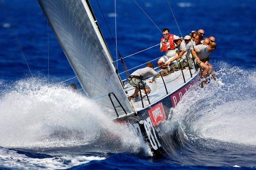 Crew hiking-out on board 'Luna Rossa' during the TP52 Audi Med Cup, Barcelona, Spain, July 2010. : Stock Photo