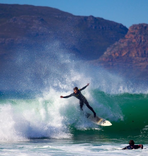 Stock Photo: 4115-3914 Man surfing off Cape Town coast, South Africa, January 2010.