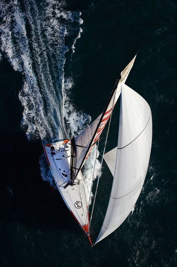 Aerial view of IMOCA open 60 'President' training ahead of the Barcelona World Race. Port la Foret, Brittany, France, November 2010. : Stock Photo