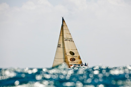 Stock Photo: 4115-4136 Lancelot' obscured by glistening wave during the Grenada Sailing Festival, Caribbean, January 2010.