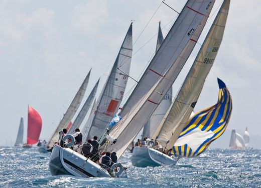 Stock Photo: 4115-4155 Fleet racing in the sun during the Heineken Regatta, St Martin, Caribbean, March 2011.