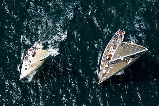 Aerial view of two yachts racing at the beginning of the Newport-Bermuda Race, Rhode Island, USA, June 2010. All non-editorial uses must be cleared individually. : Stock Photo