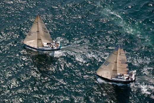 Stock Photo: 4115-4158 Aerial view of J44s 'Runaway' and 'Gold Digger' racing at the beginning of the Newport-Bermuda Race, Rhode Island, USA, June 2010. All non-editorial uses must be cleared individually.