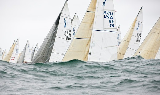 Stock Photo: 4115-4208 Fleet obscured by wave during racing in the J80 World Championships, Newport, Rhode Island, USA, October 2010.
