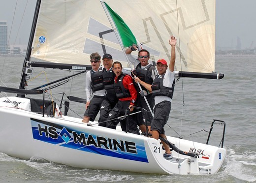 Stock Photo: 4115-4244 Crew celebrating on board overall winner 'UkaUka Racing' at the Melges 24 World Championships Corpus Christi, Texas, USA, May 2011.