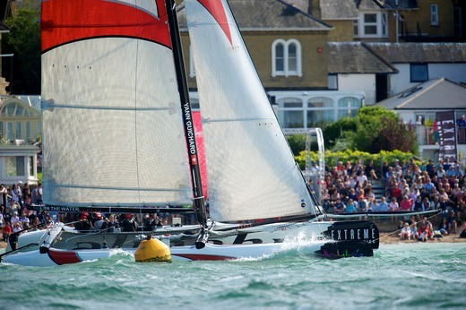 Stock Photo: 4115-4332 Alinghi' passing crowds of spectators on day two of the Extreme 40 Sailing Series in Cowes. Isle of Wight, England, August 2011. All non-editorial uses must be cleared individually.