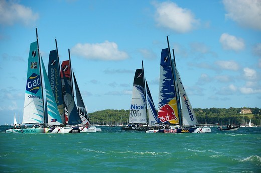 Stock Photo: 4115-4334 Red Bull Extreme Sailing' leading the fleet on day two of the Extreme 40 Sailing Series in Cowes. Isle of Wight, England, August 2011. All non-editorial uses must be cleared individually.