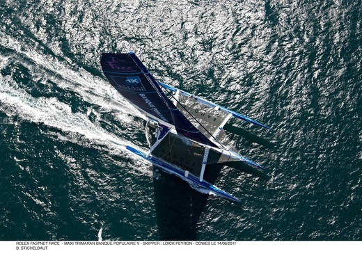Maxi-trimaran 'Banque Populaire V' skippered by Loick Peyron during the RORC Rolex Fastnet Race. Isle of Wight, England, August 2011. All non-editorial uses must be cleared individually. : Stock Photo