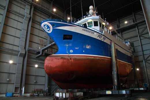 Stock Photo: 4115-4453 Fishing vessel in shiplift facility awaiting repair. Peterhead, Scotland, July 2011.