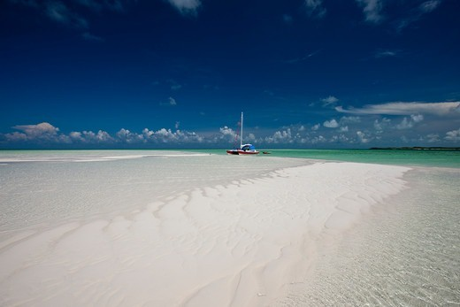 Stock Photo: 4115-4739 30ft Tiki catamaran 'Abaco' pulled up near sand bank in the Exumas, Bahamas, Caribbean. June 2009. Property released.