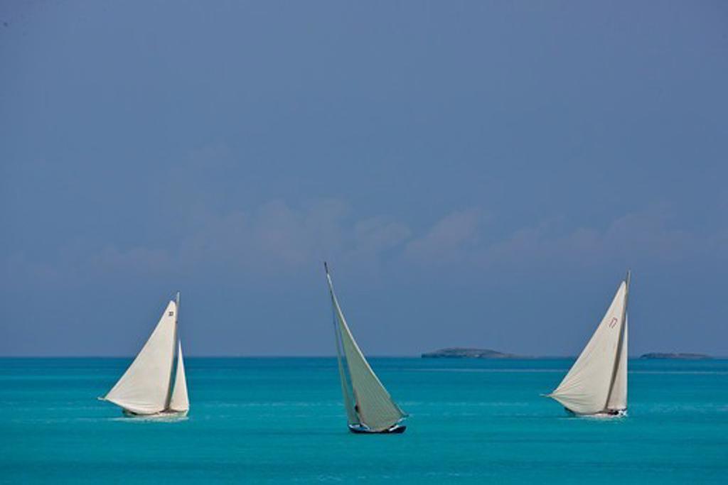 Three boats sailing on turquoise seas during the Bahamian Sloop regatta, Georgetown, Exumas, Bahamas. April 2009. : Stock Photo