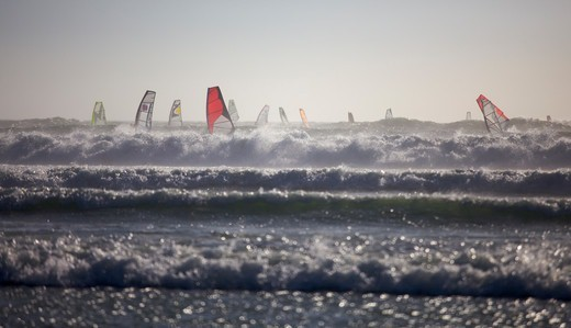 Stock Photo: 4115-4800 Windsurfers in waves off the coast of Cape Town, South Africa, January 2010.