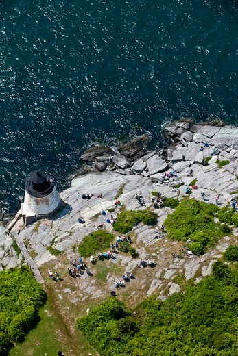 Stock Photo: 4115-4888 Aerial view of spectators gathering on the rocks by Castle Hill lighthouse at the beginning of the Newport-Bermuda Race, Rhode Island, USA, June 2010.