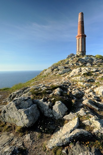 Chimney stack of old abandonned tin mine on Cape Cornwall, nr St Just, Cornwall, UK. June 2009. : Stock Photo