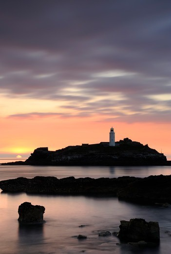 Stock Photo: 4115-5395 Godrevy Lighthouse at sunset, nr Hayle, Cornwall, UK. June 2009.