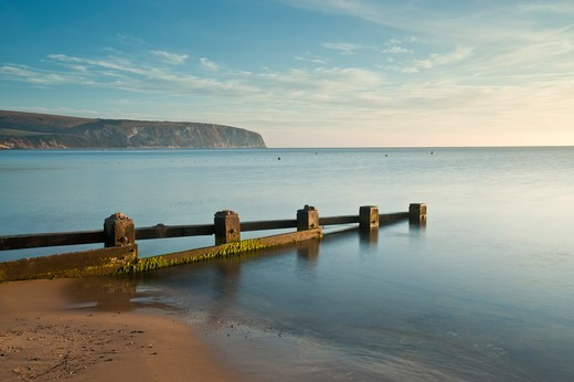 Stock Photo: 4115-5473 Swanage bay (Blue Flag beach) with groyne in early morning. Dorset, UK. September 2009.