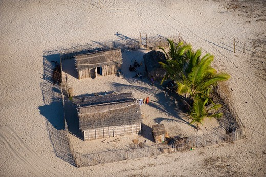 Stock Photo: 4115-5601 Aerial view of enclosure of huts in fishing village on coast of West Morondava, Madagascar. November 2008